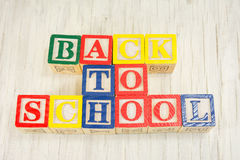 Back to school written in wooden cubicle letters Stock Images