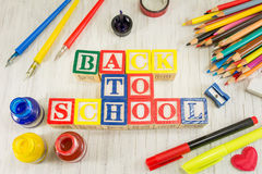 Back to school written with wooden cubicle letters Stock Photography