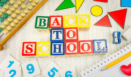 Back to school written with wooden cubicle letters Royalty Free Stock Photos
