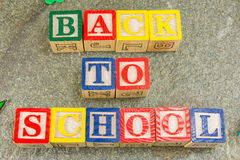 Back to school written with wooden letters on stone Stock Photography