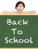 Back to school, young student girl with blackboard Royalty Free Stock Photos