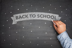 Back to shool on blacboard Stock Photo