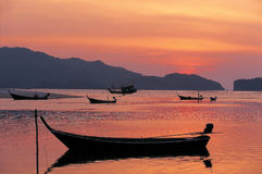 Back to shore before the last light at Pak Meng Beach in Trang. Royalty Free Stock Photo