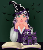 Back to Witch School. Cute little witch and book Stock Photography
