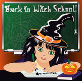 Back to Witch School. Cute little witch studying Royalty Free Stock Photo