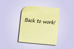 Back to work. Post-it with back to work note Stock Image