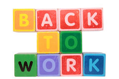 Back to work in toy block letters stock photos