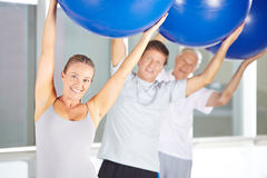 Back training with gym ball in fitness center Royalty Free Stock Photography