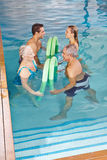 Back training with hydrotherapy. Group doing back training with hydrotherapy in a swimming pool Stock Photography