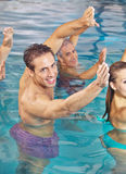 Back training in water in hydrotherapy class. Group doing back training in water in hydrotherapy class in a swimming pool Royalty Free Stock Photo