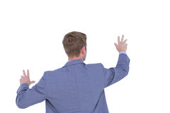Back turned businessman gesturing with hands Royalty Free Stock Photos