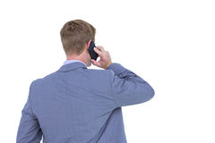 Back turned businessman on the phone. On a white background Royalty Free Stock Image