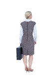 Back turned businesswoman holding a briefcase Royalty Free Stock Photography