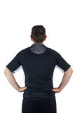 Back turned rugby player with hands on hips Stock Image