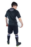 Back turned rugby player holding a ball Stock Photos