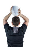 Back turned rugby player throwing a ball Royalty Free Stock Photography