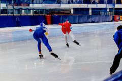Back two men speed skaters Royalty Free Stock Images