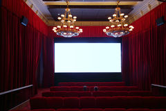 Back of two men watching movie in cinema hall. With big lusters Royalty Free Stock Photo