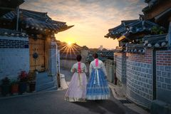 Back of two women wearing hanbok walking through the traditional. Style houses of Bukchon Hanok Village in Seoul, South Korea Royalty Free Stock Image