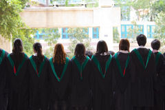 Back of university graduates with their gowns Stock Photography