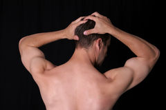 BACK IT UP. Man's back, holding head Royalty Free Stock Image