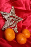 Back in USSR - mandarins, scarlet cloth and star like a symbol of the soviet new year's holidays Stock Photo