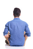Back veiw of a seated young brunette man Royalty Free Stock Images