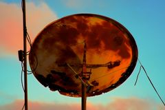Back of a very old rusty satellite television antenna royalty free stock photos