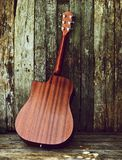 Back view acoustic guitar on wood. Stock Images
