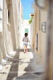 Back view of Adorable girl walking alone in narrow Royalty Free Stock Photography