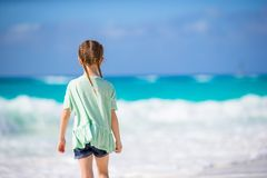 Back view of adorable little girl at beach royalty free stock photography