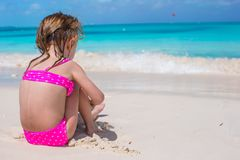 Back view of adorable little girl in swimsuit at Royalty Free Stock Images