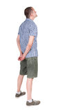 Back view of adult man in shirt and shorts  looking. Stock Photos