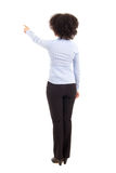 Back view of african american business woman pointing at somethi Stock Photo