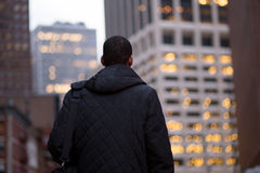 Back view of African American man going to work early in the win Royalty Free Stock Photography