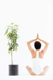 Back view of african american woman in traditional yoga pose Royalty Free Stock Photos