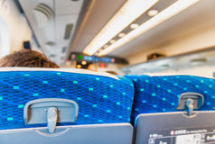 Back view of airplane passengers seats Royalty Free Stock Images