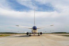 Back view of airplane standing on runway Stock Photography