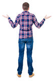 Back view of angry young man in jeans and checkered shirt. Rear view. isolated over white. backside view of person.  Rear view people collection. Isolated over Stock Image