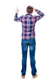 Back view of angry young man in jeans and checkered shirt Stock Photos