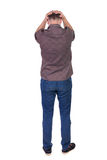 Back view of angry young man in jeans and shirt. Rear view. isolated over white. backside view of person. Rear view people collection. Isolated over white Royalty Free Stock Photo