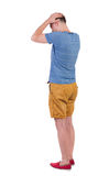 Back view of angry young man in shorts and t-shirt. Rear view. isolated over white. backside view of person. Rear view people collection. Isolated over white stock image