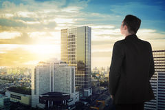 Back view of asian business man looking the sky Royalty Free Stock Photography