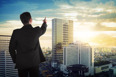 Back view of asian business man looking the sky Royalty Free Stock Image