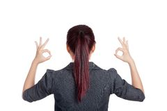 Back view of Asian business woman show double OK h Royalty Free Stock Photography