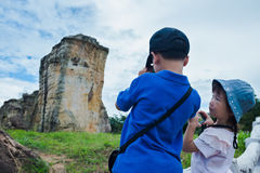 Back view of asian children taking photos by camera. Back view of asian children taking photos by camera at national park . Family relaxing outdoors with bright Royalty Free Stock Images