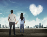 Back view of asian couple holding hand looking at the sky Royalty Free Stock Image