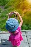 Back view of asian girl relaxing outdoors in the daytime, travel. Back view of asian girl learning take photographs at view point. Child relaxing outdoors with Stock Images