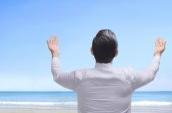 Back view of asian muslim man raising hand and praying Royalty Free Stock Image