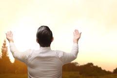 Back view of asian muslim man raising hand and praying Stock Photography